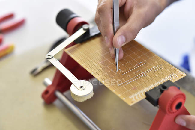 Assembling of a circuit board — Stock Photo