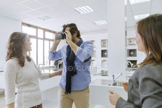 Man in virtual reality glasses in plumbing shop — Stock Photo
