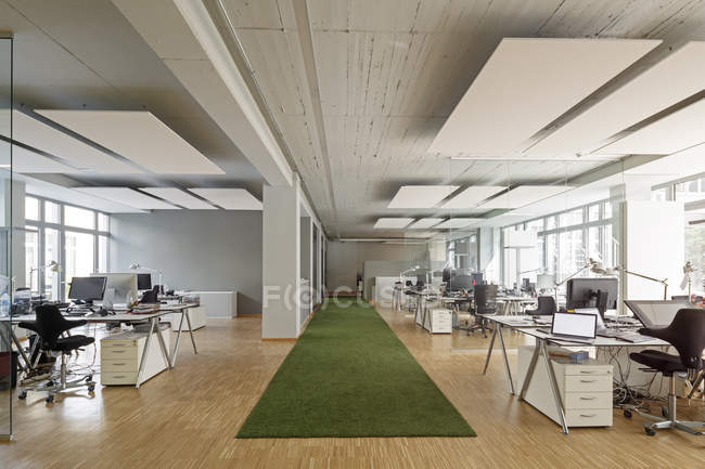 Modern office interior with working places — Stock Photo