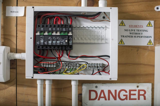 Close-up of Electrical panel for students on wooden wall — Stock Photo