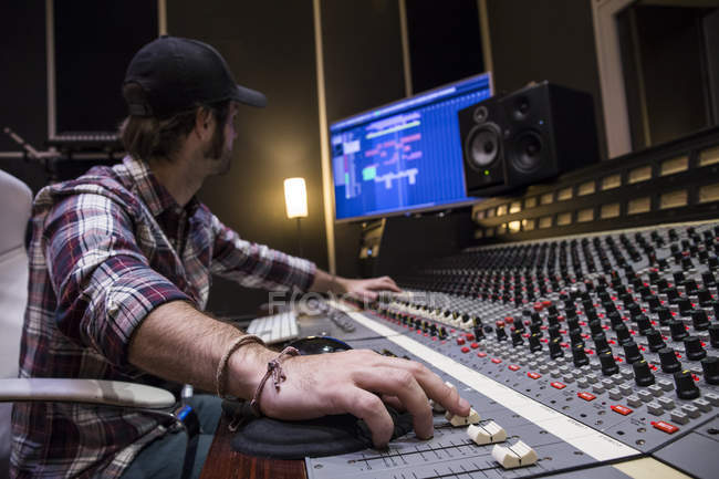 Man working in the control room of a recording studio — Stock Photo