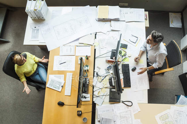 Male and female architects working in office — Stock Photo