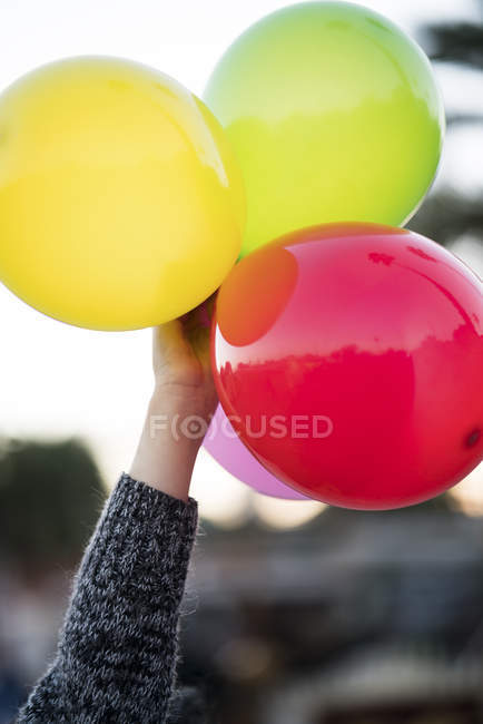 Woman holding colorful balloons — Stock Photo