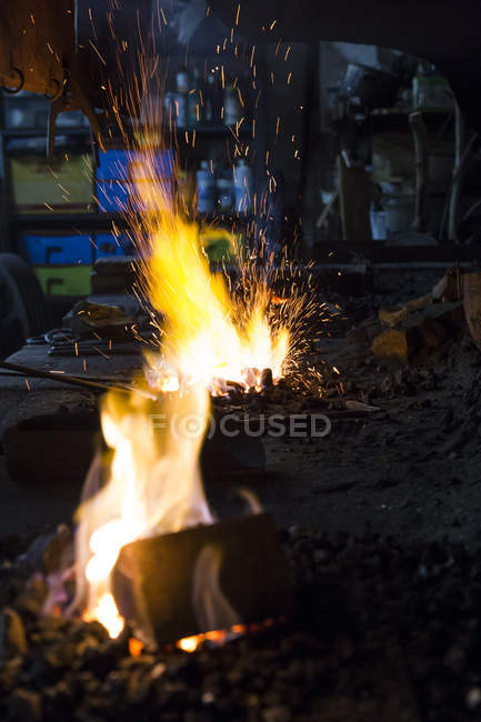 Close-up of Blacksmith fire burning in workshop — Stock Photo