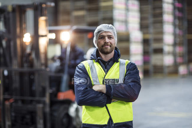 Portrait of confident warehouseman — Stock Photo
