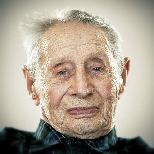 Portrait of calm senior man looking at camera — Stock Photo