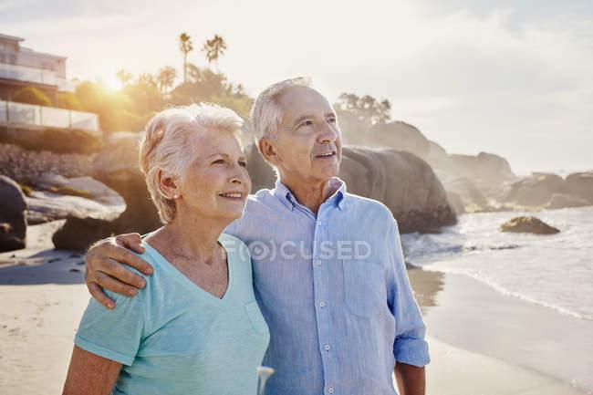 Portrait of smiling senior couple  on the beach — Stock Photo