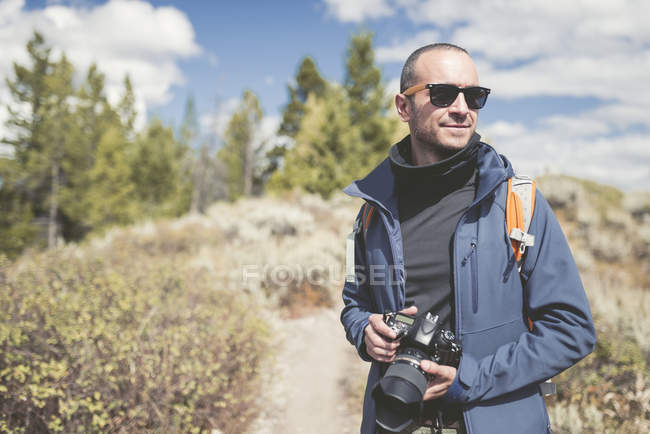 USA, Wyoming, man with camera at Grand Teton National Park — Stock Photo