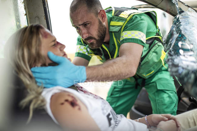 Paramedic Helping Car Crash Victim After Accident Color Image Two