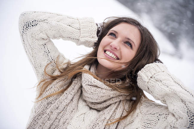 Young woman having fun in snow — Stock Photo