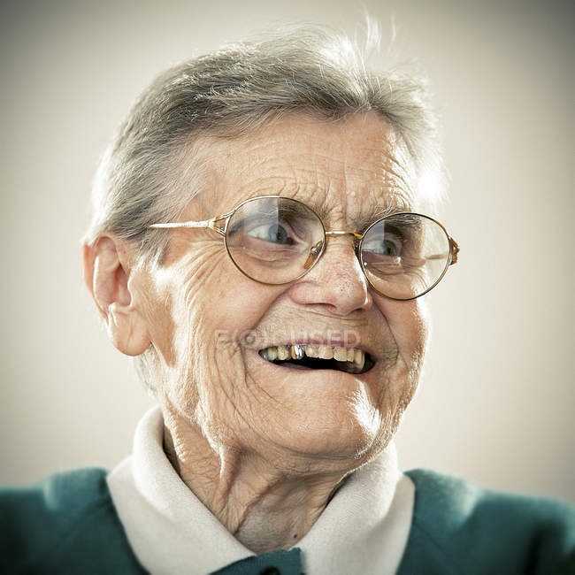 Portrait of smiling senior woman looking aside — Stock Photo