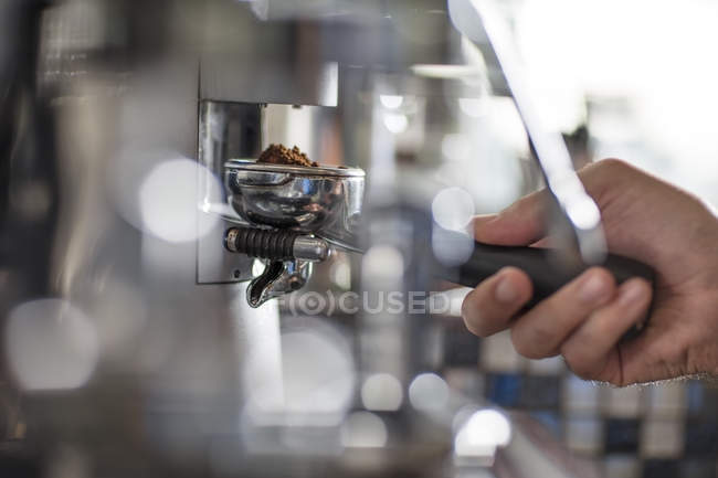 Barista using espresso machine — Stock Photo