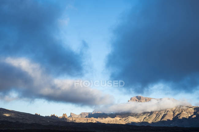 Spain, Tenerife, Teide National Park with mountains in clouds — Stock Photo