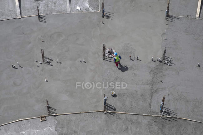 Worker on construction site, top view — Stock Photo