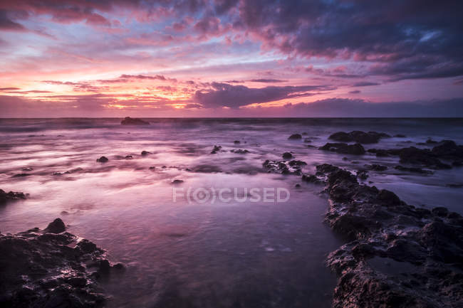 Spain, Tenerife, rocky sea coast at sunset — Stock Photo