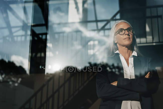 Businesswoman looking out of window — Stock Photo