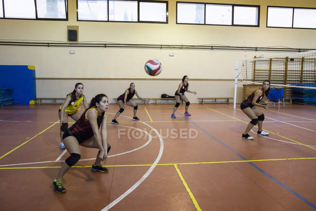 Volleyball player digging the ball during a volleyball match — Stock Photo