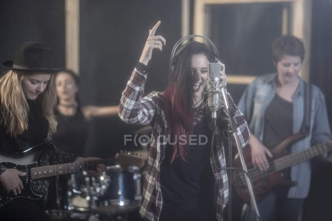 Female rock band in recording studio — Stock Photo