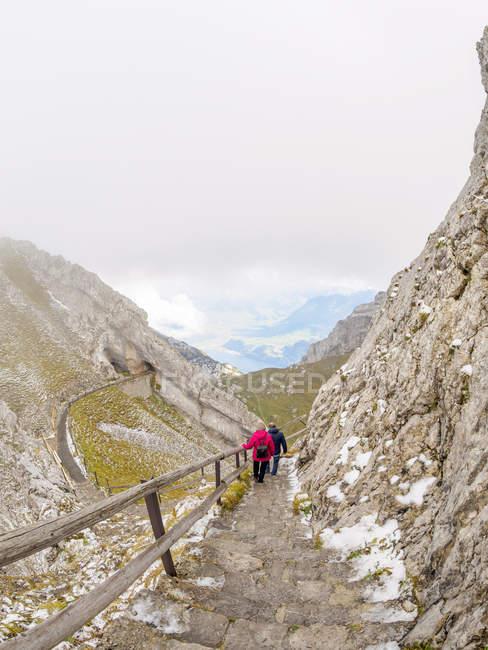 Switzerlans, Senior couple hiking in Emmental Alps — Stock Photo