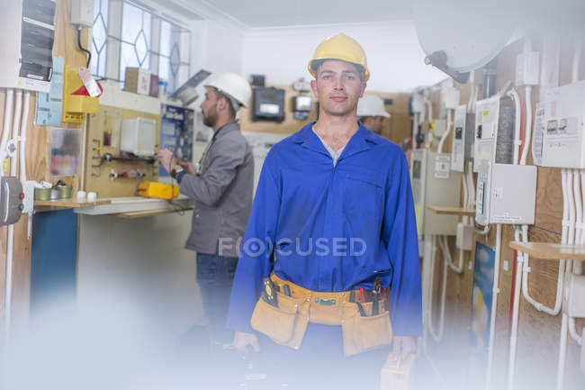 Electrician training, student with hardhat and toolbelt — Stock Photo