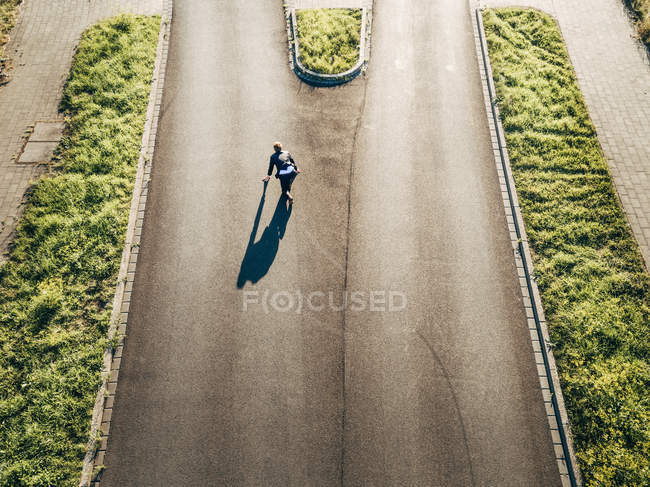 Confident Businessman starting race on road — Stock Photo