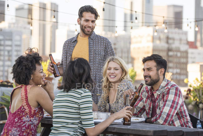 Friends at rooftop party, Los Angeles, USA — Stock Photo