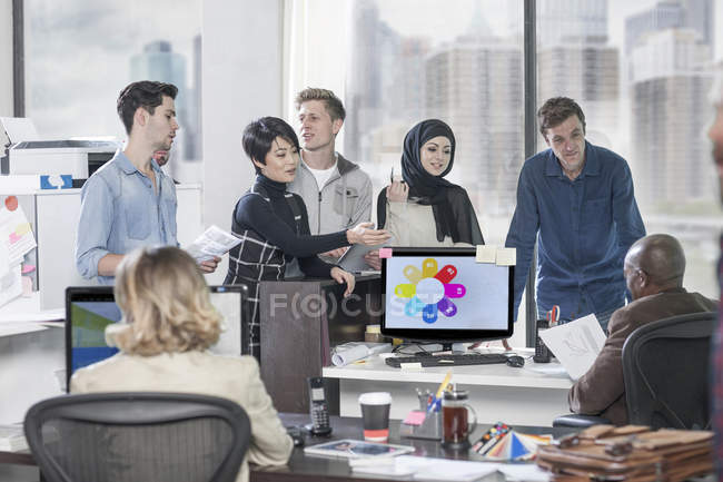 Businesswoman leading informal meeting in modern office — Stock Photo