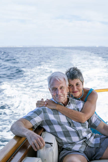 Smiling couple on boat trip looking at view — Stock Photo