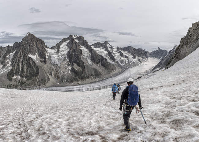 France, Chamonix, Grands Montets, group of mountaineers trekking in winter — Stock Photo