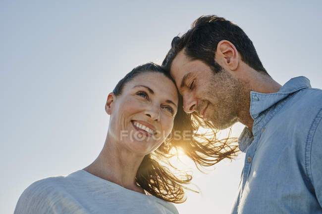 Portrait of smiling mid adult couple touching heads — Stock Photo