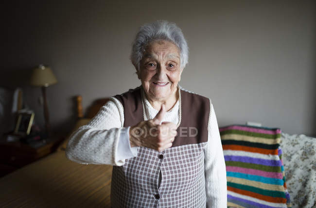 Old woman with positive hand sign — Stock Photo