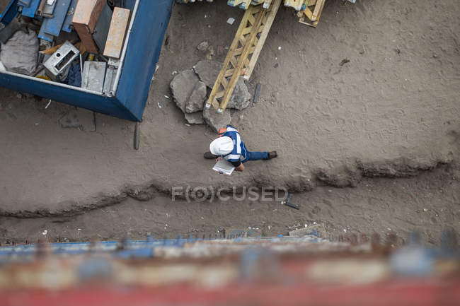 Man walking on construction site at daytime — Stock Photo