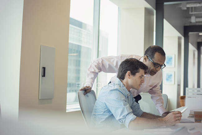 Two businessmen working together in office — Stock Photo