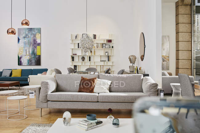 Sofa in furniture store decorated interior — Stock Photo