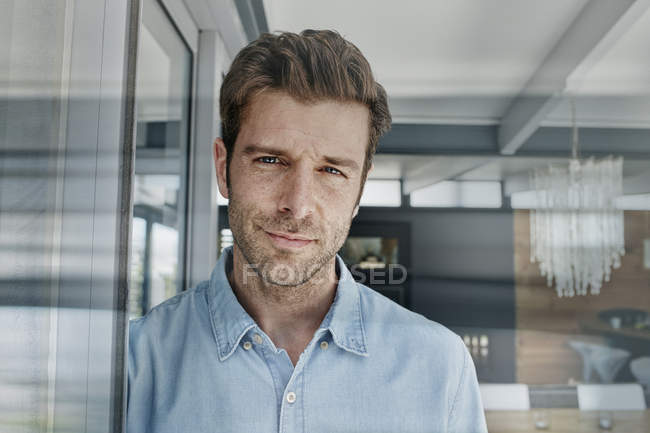 Portrait of smiling mid adult man indoors — Stock Photo