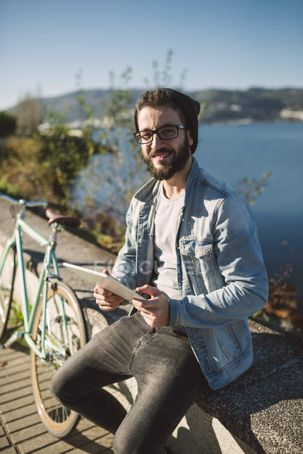 Portrait of young man holding tablet, Ferrol, Galicia, Spain — Stock Photo