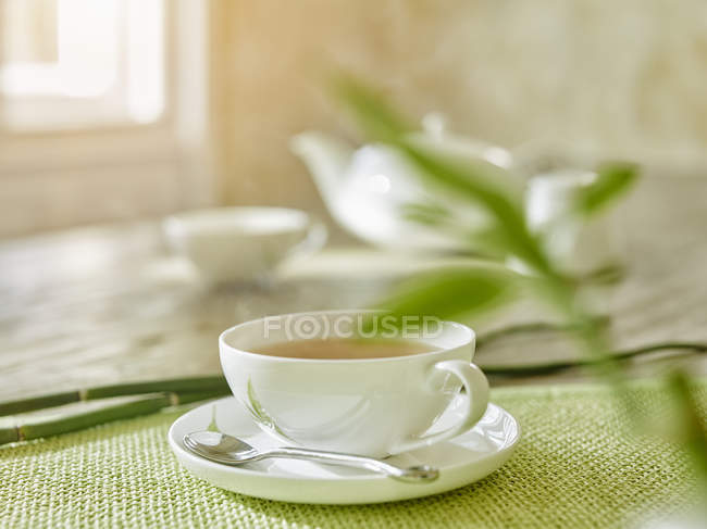 Cup of steaming tea on table — Stock Photo