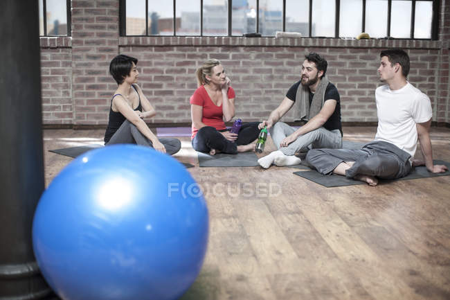 Group of people in yoga class studio — Stock Photo