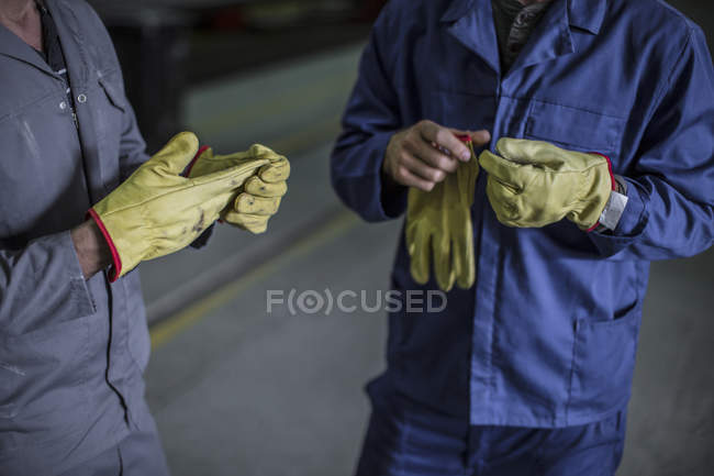 Close-up of factory worker's hands — Stock Photo