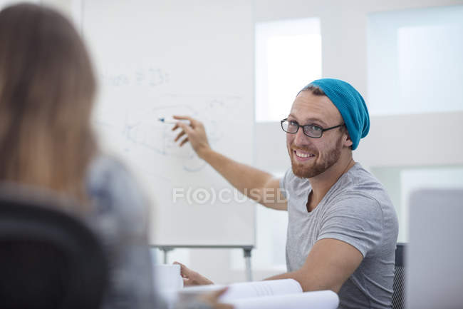 Two office workers discussing project together in office — Stock Photo
