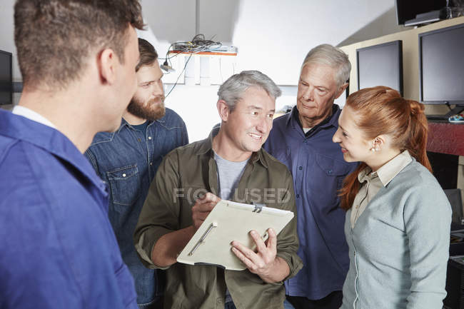 Staff of computer recycling plant working together — Stock Photo