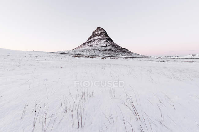 Kirkjufell and snow at sunset, Iceland. — Stock Photo