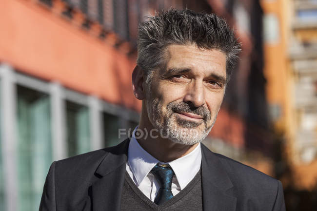 Portrait of confident businessman standing outdoors — Stock Photo
