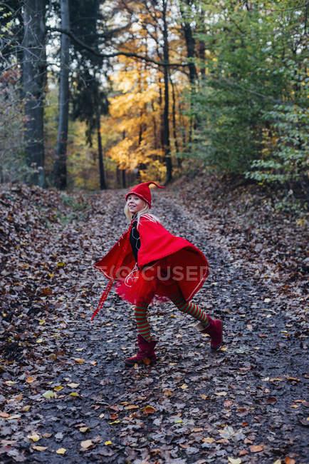 Little female imp running in forest — Stock Photo