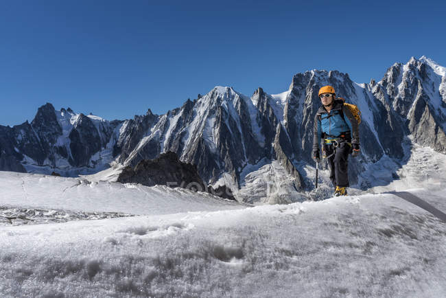France, Chamonix, Argentiere Glacier, Les Droites, Les Courtes, Aiguille Verte, mountaineer hiking in snow covered mountains — Stock Photo