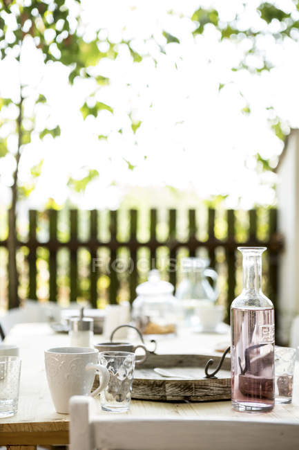 Close-up of wooden laid table in garden — Stock Photo