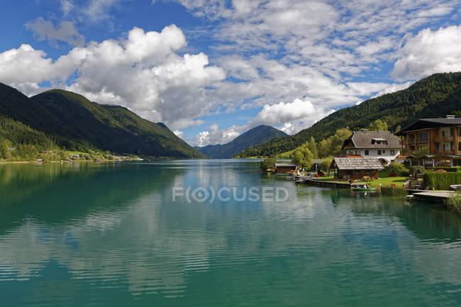 Austria, Carinthia, Boat houses at Lake Weissensee — Stock Photo