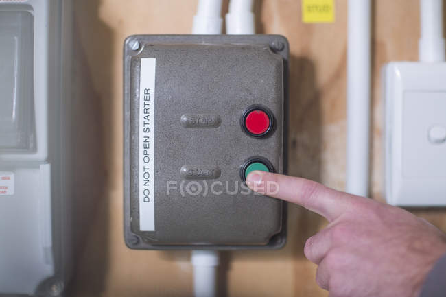 Cropped image of Hand turning on electrical control box — Stock Photo