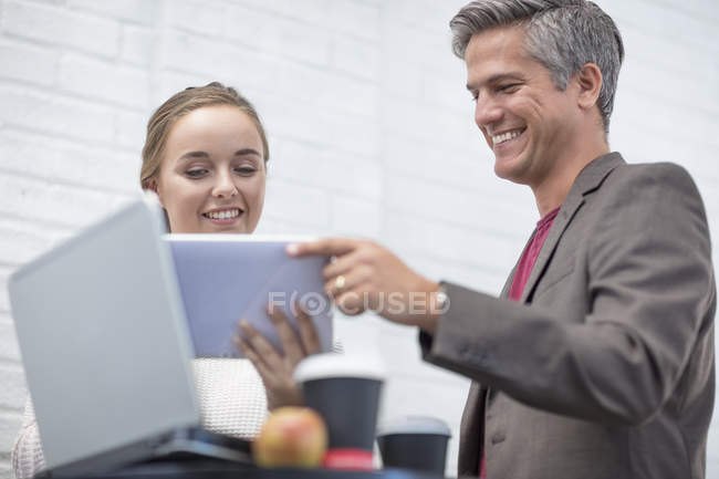 Businessman and office female working together during meeting — Stock Photo