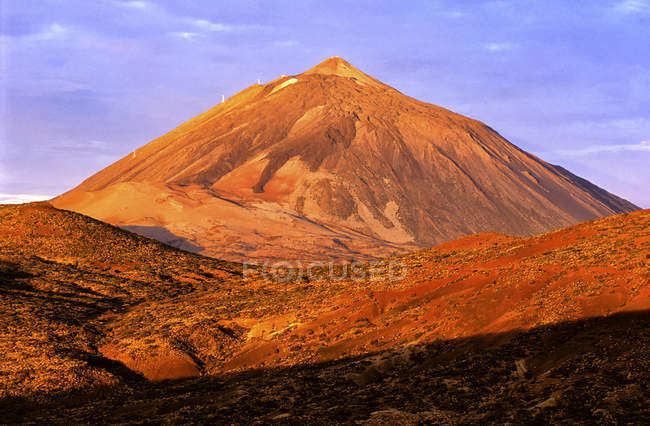 Sunrise over Teide National Park with a cloud on top of Teide volcano, Teide National Park. — Stock Photo